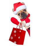 Christmas dog. Santa claus christmas dog  isolated on white background, waving hands, and shopping on sale Stock Photography