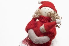 Christmas doll. Homemade rag-doll in christmas colors Royalty Free Stock Image