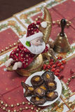 Christmas Doll with gingerbread brownies Royalty Free Stock Photo