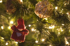 Christmas doll. Little hand made doll on the Christmas tree Royalty Free Stock Photography