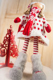 Christmas Doll and a red christmas tree Royalty Free Stock Photography