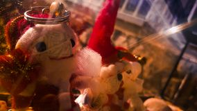 Christmas doll in a sunny day royalty free stock images