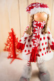 Christmas doll waiting for Santa Stock Photo
