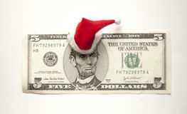 Christmas dollar. Dollar bill in a Christmas hat Royalty Free Stock Image