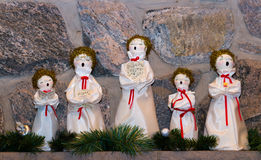 Christmas dolls singing carols. A group of Christmas dolls singing carols stock photos