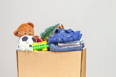 Christmas donation box with toys, books, clothing for charity royalty free stock image