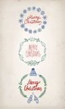 Christmas  doodle  hand drawn frames. Set of Christmas  doodle  hand drawn frames with greeting text on paper background Stock Photos