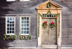 Christmas Door. Christmas wreaths and garlands decorating an old wood house Stock Photography