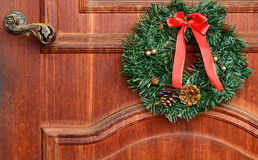 Christmas door decoration on the old door Royalty Free Stock Images