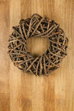 Christmas Door Wreath Brown on Sapele Wood Background Stock Images