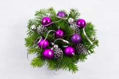Christmas door wreath with silver pine cones and purple baubles. royalty free stock image