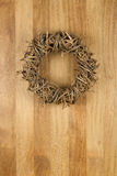 Christmas Door Wreath Light Brown on Sapele Wood Background Royalty Free Stock Photo