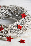 Christmas door wreath made of twigs with red stars. Christmas door wreath made of twigs monochrome with red deco stars stock photography