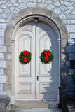 Christmas Doors. An pretty door with two wreaths hanging on it Royalty Free Stock Images