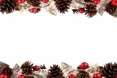 Christmas double border with rustic wood tree ornaments, baubles and pine cones isolated on white Royalty Free Stock Photography