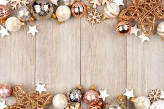 White and gold Christmas ornament double border on wood Royalty Free Stock Photo