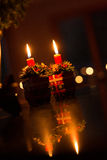 Christmas by Double Candle Light with Reflection Royalty Free Stock Photo