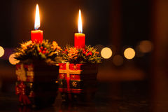 Christmas by Douple Candle Light. Setting the mood during the festive seasons.. Moody and Festive you almost can feel the warmth and smell the aroma scented stock photography