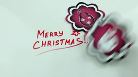 Christmas congratulation and the falling pictures stock video