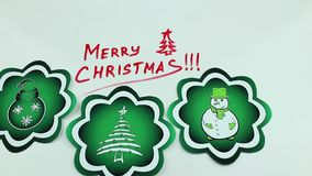 Christmas congratulation and green pictures. The Christmas drawing made a marker on white stock video footage