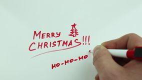 Christmas congratulation and Santa`s laughter. The Christmas drawing made a marker on white stock footage