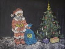 Christmas drawing. Santa claus near christmas tree on child drawing on a blackboard Royalty Free Stock Photos