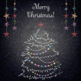 Christmas drawing tree on the blackboard background Stock Photos