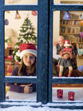 Christmas dream. Child looking outside on Christmas eve Stock Photography