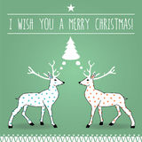 Christmas Dream postcard. A retro lettering Merry Christmas Wish under a star and two white rein deers on a green square background dreaming a Christmas Tree stock illustration