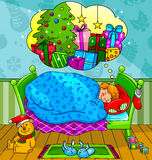 Christmas dreams. Little boy dreaming about Christmas presents Stock Photo