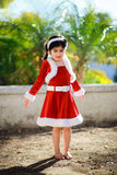 Christmas dress. Little girl outside wearing a christmas dress Stock Images