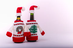 Christmas dressed bottles. Over a white - gray background Stock Image