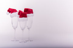 Christmas dressed cups. Three Christmas dressed champagne cups over a white - gray background Royalty Free Stock Photos