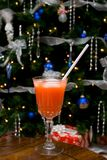 Christmas Drink. A drink and straw set with a Christmas tree as a background stock images