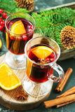 Christmas drink. With fruits and aroma spice Stock Photos