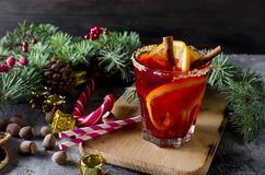 Christmas drink with fruits and aroma spices, fir branches. Traditional hot toddy winter drink with spices recipe. Healthy organic homemade holiday celebration Stock Images