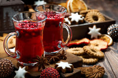 Christmas drink hot cranberry tea and cookies on dark background Stock Image