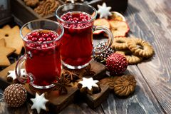 Christmas drink hot cranberry tea and cookies on dark background Stock Photo