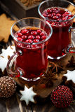 Christmas drink hot cranberry tea and cookies, vertical, closeup Royalty Free Stock Photography