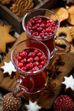 Christmas drink hot cranberry tea and cookies, vertical Royalty Free Stock Images