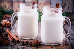 Christmas drink: hot white chocolate with cinnamon stick in mason jars Stock Photography