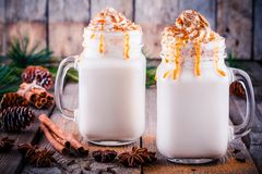 Christmas drink: hot white chocolate with whipped cream and caramel in mason jars Royalty Free Stock Photos