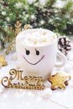 Christmas drink with marshmallow. Christmas composition. Christmas drink with marshmallows in cup with smile . Christmas composition Stock Image