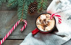 Christmas drink. Mug hot coffee with marshmallow, red candy cane on the wooden background. New Year. Holiday card. Rustic style. T Royalty Free Stock Photography