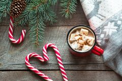 Christmas drink. Mug hot coffee with marshmallow, red candy cane on the wooden background. New Year. Holiday card. Rustic style. T. Op view and copy space stock images