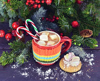 Christmas drink in warm knitted cup Stock Photos