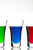 Christmas drinks. Tree diferent colors of drink Stock Photos