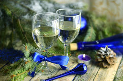 Christmas drinks in glasses on a background of festive decorations in blue colors Royalty Free Stock Image