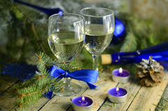 Christmas drinks in glasses on a background of festive decorations in blue colors Stock Image
