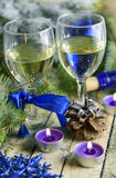 Christmas drinks in glasses on a background of festive decorations in blue colors Royalty Free Stock Images